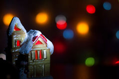 Christmas light house on a background of colorful bokeh Stock Images