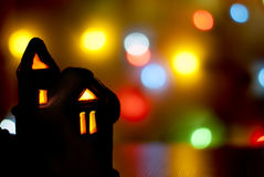 Christmas light house on a background of colorful bokeh Royalty Free Stock Photography