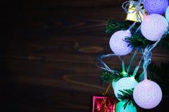 Christmas light ornaments hang on Christmas tree have space. Stock Photos