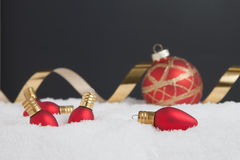Christmas light ornaments in the snow Stock Image