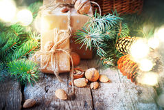 Christmas Light with Presents. Boxes Decorated Cord, Coniferous, Pine Cones, Nuts. Stock Photos