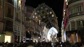 Christmas light show in Malaga, Spain. MALAGA, SPAIN - DECEMBER 11, 2017: Crowd of people watch Christmas Light Show on Calle Marques de Larios street in the stock footage