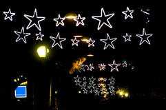 Christmas light stars. Blury white lights_red bright balls behind Stock Photography