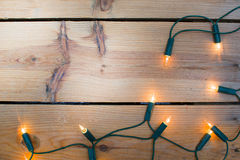 Christmas light on wood Royalty Free Stock Photography