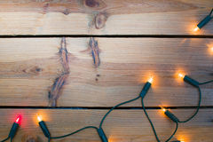 Christmas light on wood Stock Images