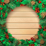 Christmas light wooden background with holly berries, pine branc. High detailed vector round frame. There is copy space for your text in the center Royalty Free Stock Photo