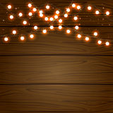 Christmas light on wooden background Royalty Free Stock Images