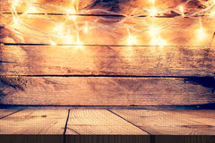 Christmas light on wooden background and wooden table, Vintage C Stock Image