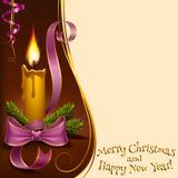 Christmas lighted candle Stock Photography