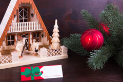 Christmas lighthouse with nameplate and dark wooden background Royalty Free Stock Image