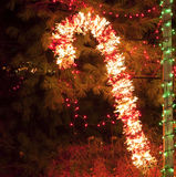 Christmas Lighting with Brightly Lit Candy Cane Royalty Free Stock Images