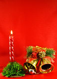 Christmas lighting candle and golden jingle bells Royalty Free Stock Photos