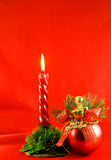 Christmas lighting candle and red ball stock image