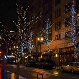 Christmas Lighting in Portland, Oregon, USA. Christmas lighting and decorations along the streets and Parks in the Pearl District, Portland, Oregon, on a rainy royalty free stock photo