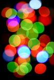 Christmas lights. Abstract blur of festive multi-colored lights royalty free stock photos