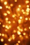Christmas lights. Orange glowing blur of lights for Christmas or Halloween stock photo