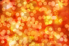 Christmas lights. Sparkling festive background of golden Christmas lights and snowflakes Stock Photography