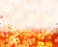 Christmas lights. Sparkling festive background of golden Christmas lights and snowflakes Stock Image