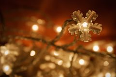 Christmas lights. Snowflake christmas lights on dark red background Stock Photography
