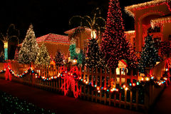 Christmas lights. Bright christmas lights on the house and landscape Royalty Free Stock Photo