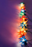 Christmas lights. On dark background with copy space. Decorative garland Royalty Free Stock Photo