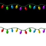 Christmas lights. Strings of Christmas lights on a black and white background Royalty Free Stock Photos
