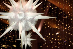 Christmas Lights. Giant Snowflakes backed by christmas lights Royalty Free Stock Image