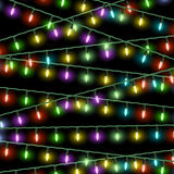 Christmas lights. Vector Christmas lights on black background Stock Photo