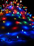Christmas lights. On a snow pile (E-1 + carl zeiss planar 50mm F1.4 Royalty Free Stock Images