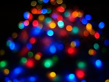 Christmas lights. On the snow pile while zooming out Royalty Free Stock Photography