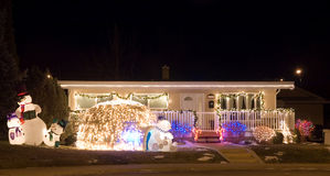 Christmas Lights 6. House decorated with colorful christmas lights - featuring snowmen and an igloo Stock Images
