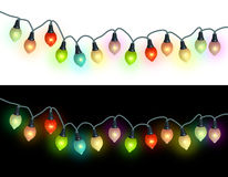 Christmas lights. Luminating in the white and black background Stock Photo
