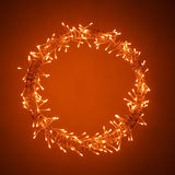 Christmas Lights. Sparkling Christmas lights on a orange background royalty free stock photography