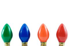 Christmas Lights. Four different colored Christmas lights isolated on white Royalty Free Stock Images