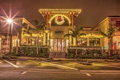 Christmas lights as sunrises over The Bevy Restaurant on the Third Street shopping district in Old Naples, Florida. Naples, Florida, USA – December 22 royalty free stock images