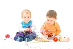 Christmas lights and babies Royalty Free Stock Photo