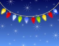 Christmas Lights Background. A background illustration of Christmas lights hanging against a blue night sky with snowflakes or stars Stock Photography