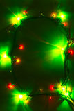 Christmas lights background with green dominant Stock Image