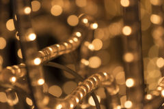 Christmas lights background. Shiny orange golden light. Perfect for creative xmas projects Stock Photography