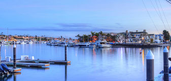 Christmas lights in Balboa Island harbor. With ships and sailboats in front of decorated homes in Southern California, USA stock photography
