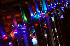Christmas lights on balcony. House balcony decorated with christmas lights at night Stock Image
