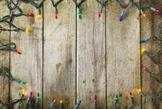 Christmas lights on vintage wood surface Stock Image