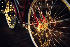 Christmas lights on bike background texture in city stock images