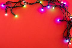 Christmas lights on blue background.  stock images