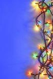 Christmas lights on blue background with copy space. Decorative garland Royalty Free Stock Image