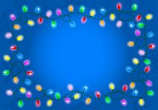 Christmas lights on blue background with space for text Royalty Free Stock Photography