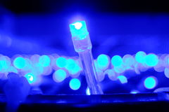 Christmas lights on blue Royalty Free Stock Images