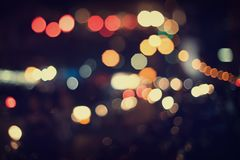 Christmas lights. Blurred bokeh background from christmas night party for your design, vintage or retro color toned Stock Photo