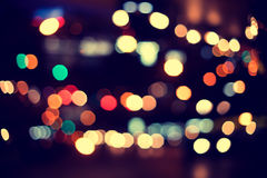 Christmas lights. Blurred bokeh background from christmas night party for your design, vintage or retro color toned Stock Photos
