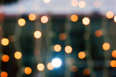 Christmas lights bokeh. Reflection in the window Royalty Free Stock Photos